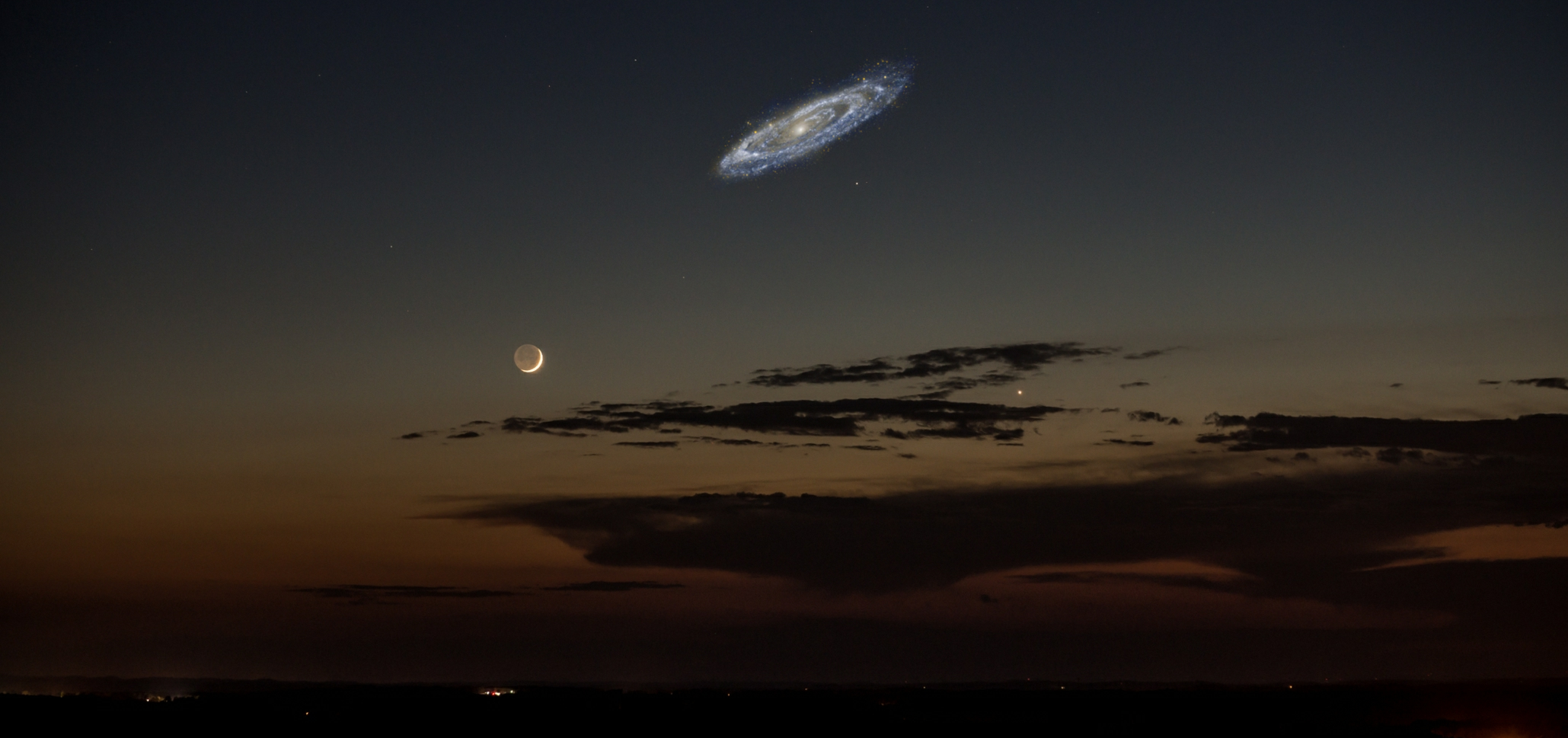 If the Andromeda Galaxy were much much brighter than it is, it would look about like this in our night sky. It's the collective luminosity of all those billions of stars that let you make out a faint murky cloudy blob of light at 2.5 million light years. In about 4 billion years, the Milky Way will collide with this galaxy.